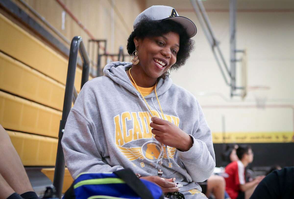 Math teacher and badminton coach Etoria Cheeks chats with students during a badminton match at The Academy San Francisco high school on Tuesday, April 4, 2017 in San Francisco, Calif.