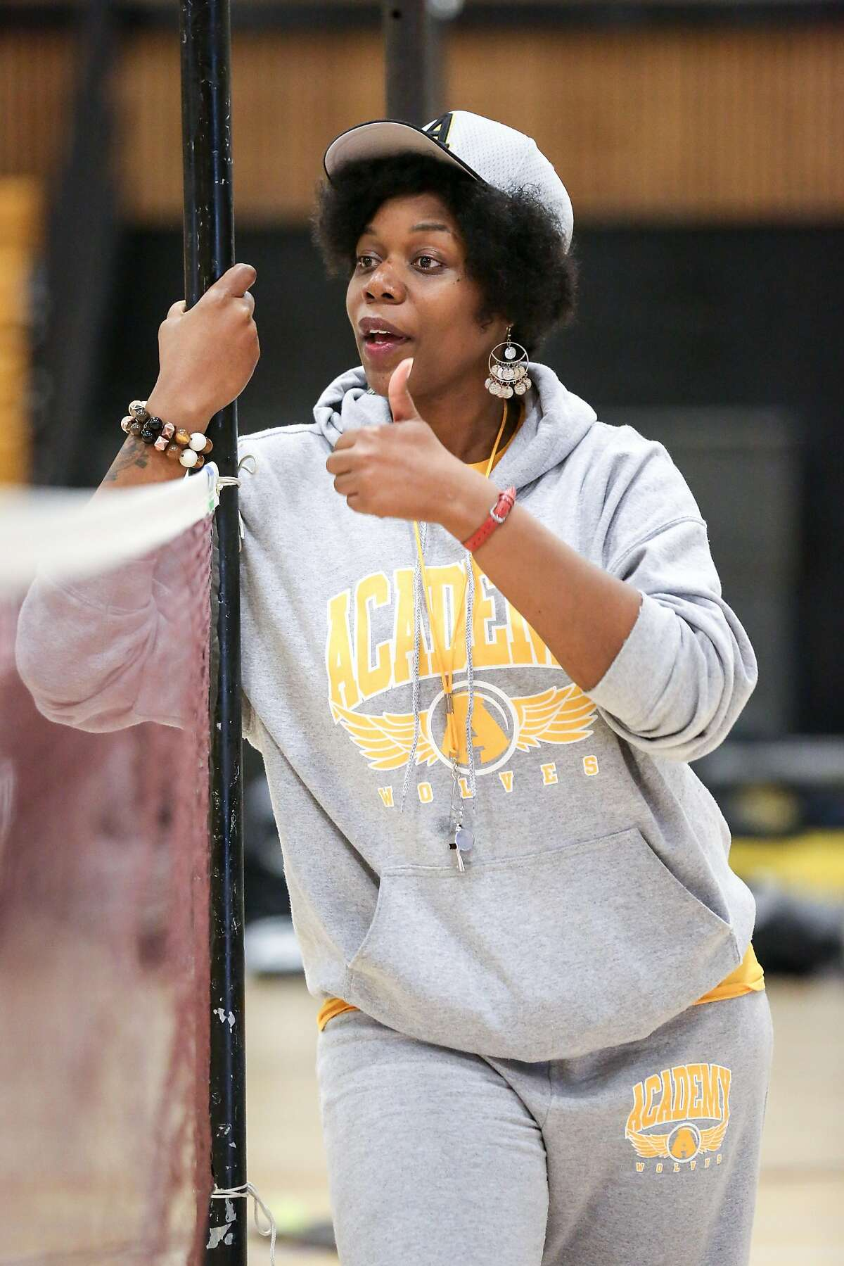 Math teacher and badminton coach Etoria Cheeks gives feedback to students during a badminton match at The Academy San Francisco high school on Tuesday, April 4, 2017 in San Francisco, Calif.