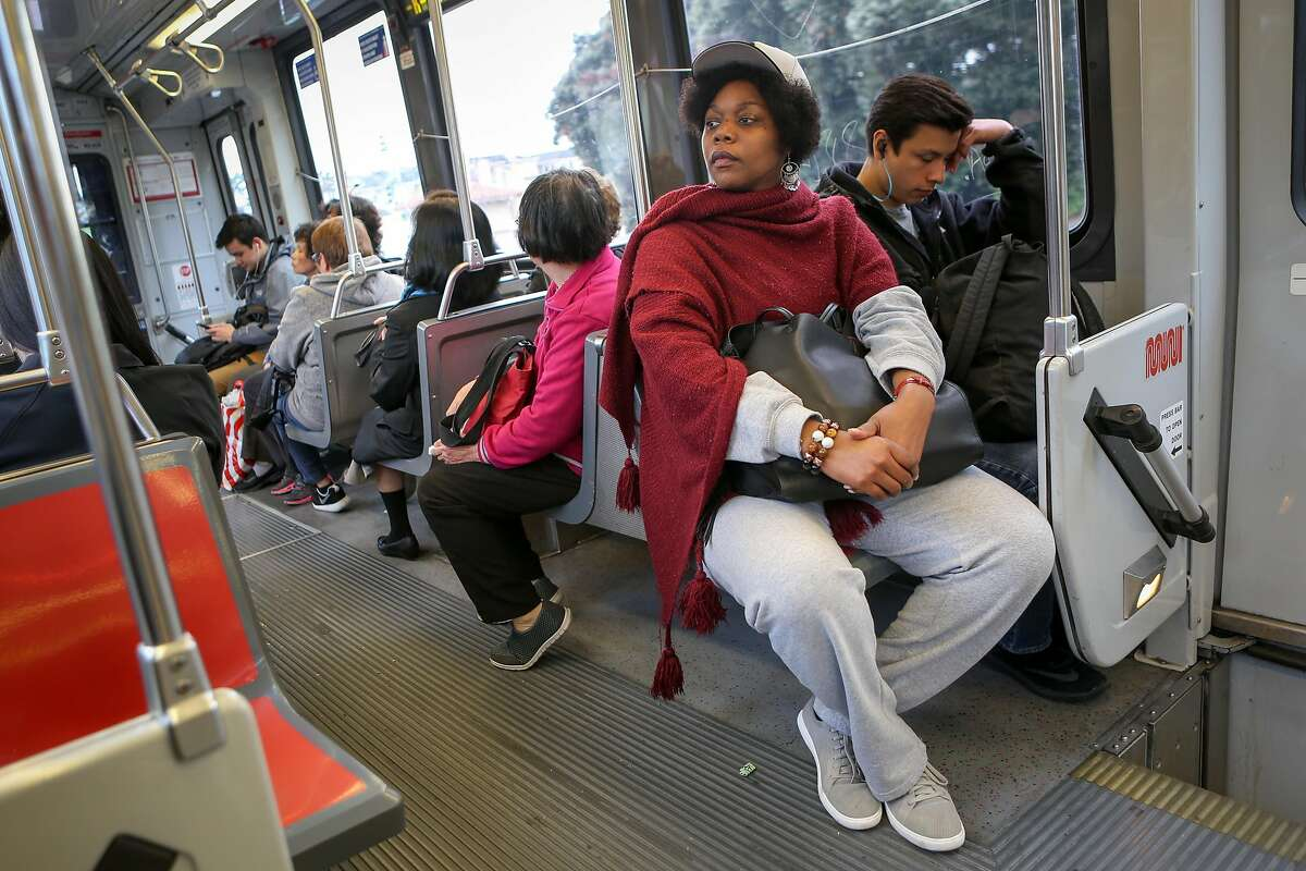 Math teacher and badminton coach Etoria Cheeks rides the train in the last leg of her trip after leaving The Academy high school to return to her temporary living situation on Tuesday, April 4, 2017 in San Francisco, Calif. It is not unusual for Cheeks to spend 12 hour days at the school.