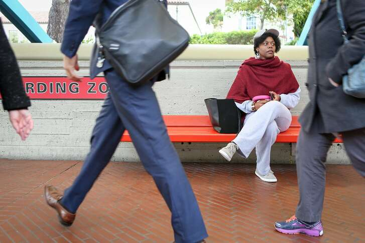 Math teacher and badminton coach Etoria Cheeks waits for the train after leaving The Academy high school to return to her temporary living situation on Tuesday, April 4, 2017 in San Francisco, Calif. It is not unusual for Cheeks to spend 12 hour days at the school.