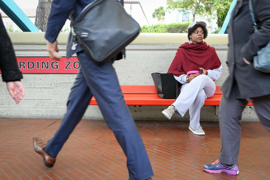 Math teacher and badminton coach Etoria Cheeks waits for the train after leaving The Academy high school to return to her temporary living situation on Tuesday, April 4, 2017 in San Francisco, Calif. It is not unusual for Cheeks to spend 12 hour days at the school. Photo: Amy Osborne / Special To The Chronicle 2015