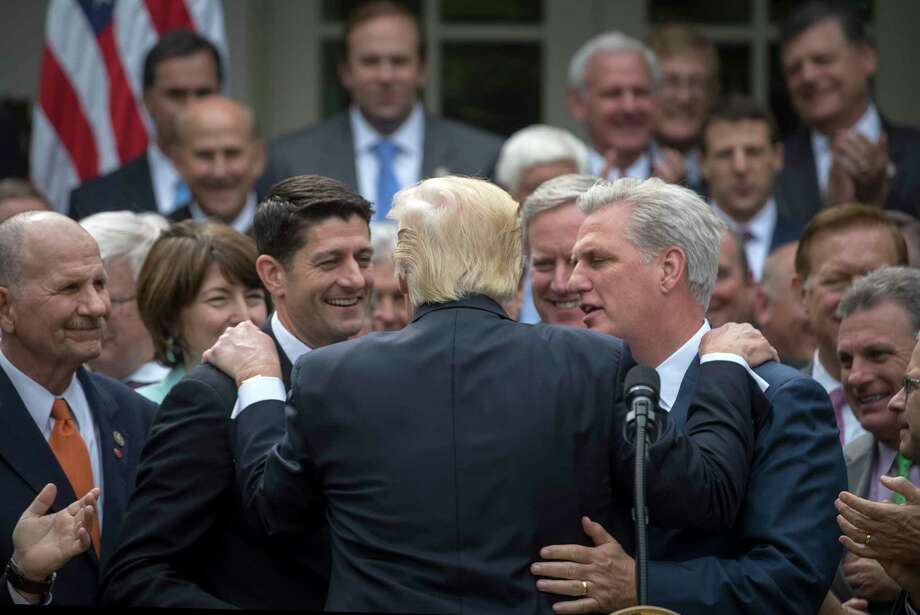 President Donald Trump is embraced by House Republican leaders as they came to the White House to celebrate the passage of the American Health Care Act, in Washington, May 4, 2017. The bill faces a more uncertain future in the Senate. From left: House Speaker Paul Ryan, R-Wis.; Trump; Rep. Mark Meadows, R-N.C., who heads the Freedom Caucus; and House Majority Leader Kevin McCarthy, R-Calif. (Photo by Stephen Crowley/The New York Times) Photo: STEPHEN CROWLEY, STF / NYTNS