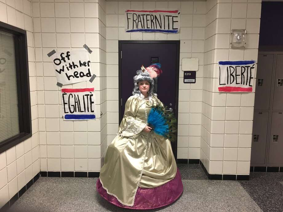 Westside High School teacher Jennalee Kwezi is seen in one of several period costumes she says she likes to use to make world history come alive to her students.