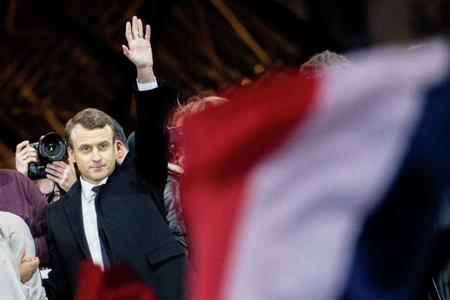 Emmanuel Macron, French presidential candidate, waves to supporters in front of the Pyramid at the Louvre Museum in Paris, France, on Sunday, May 7, 2017. Macron pledged to unite France's rifts after his victory over Marine Le Pen in the presidential election, saying that he'll work to address the concerns that were exposed during one of the most divisive campaigns of recent history. (Photo by Christophe Morin/Bloomberg) Photo: Christophe Morin / © 2017 Bloomberg Finance LP