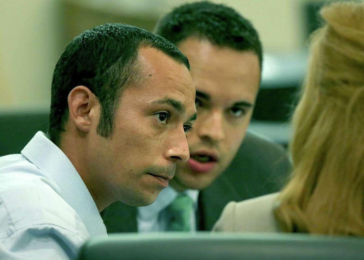 Joshua Gonzales, left, on trial for murder, sits with his lawyers in the 437th State District Court at the Caden-Reeves Justice Center where Judge Lori Valenzuela ordered a mistrial in the case on Monday, May 8, 2017.