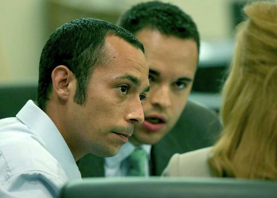 Joshua Gonzales, left, on trial for murder, sits with his lawyers in the 437th State District Court at the Caden-Reeves Justice Center where Judge Lori Valenzuela ordered a mistrial in the case on Monday, May 8, 2017. Photo: Bob Owen, Staff / San Antonio Express-News / ©2017 San Antonio Express-News
