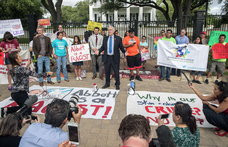 "U.S Rep. Lloyd Doggett speaks during a protest outside of the Texas Governor's Mansion in Austin, Texas, Monday, May 8, 2017. The gathering was to protest Texas' new ""sanctuary cities"" law, which takes effect in September and which critics say is the most anti-immigrant since a 2010 Arizona law, that will allow police officers to ask about the immigration status of anyone they detain, including during routine traffic stops. Republican Gov. Greg Abbott signed the law Sunday evening on Facebook Live with no advanced warning. (Ricardo B. Brazziell/Austin American-Statesman via AP) Photo: Ricardo B. Brazziell, Associated Press / Austin American-Statesman"