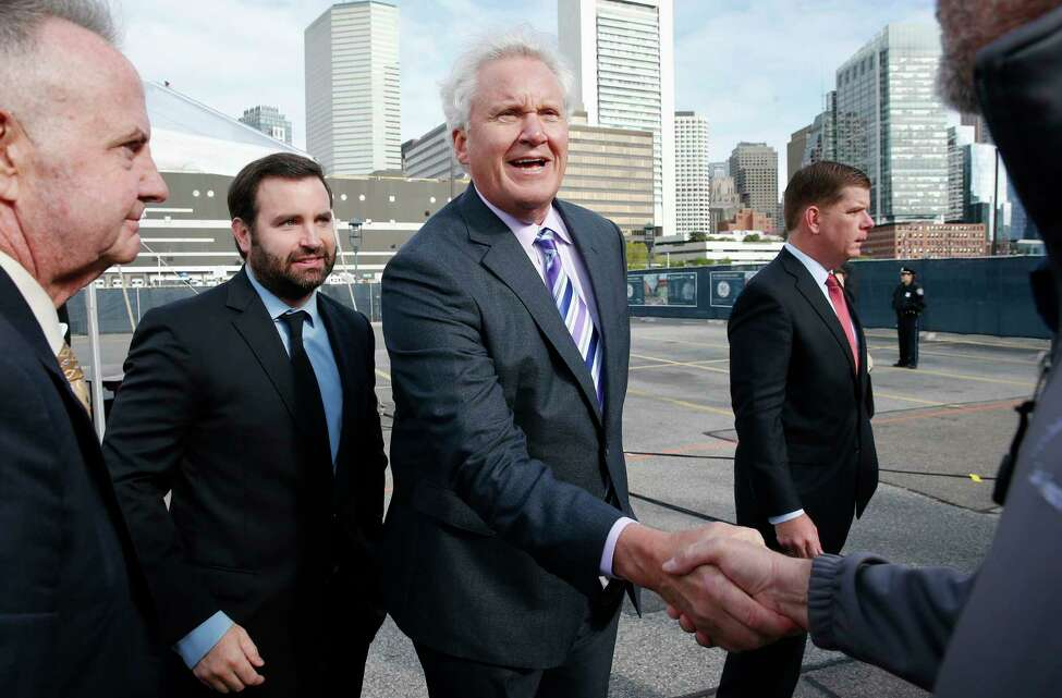 General Electric CEO Jeff Immelt, center, greets construction workers following a ceremonial groundbreaking on the site of GE's new headquarters, Monday, May 8, 2017, in Boston. (AP Photo/Michael Dwyer) ORG XMIT: MAMD101