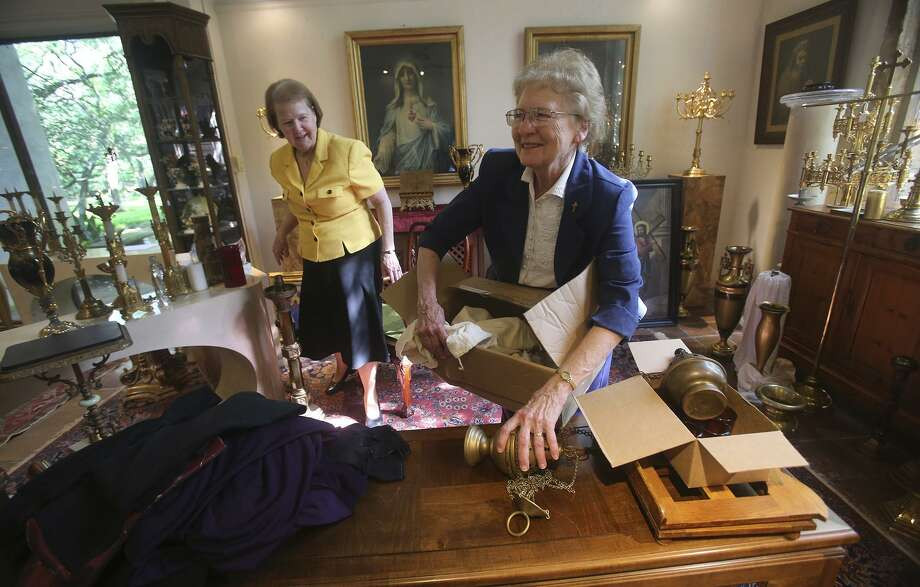 Sister Deborah Fuchs (left) and sister Gloria Ann Fiedler (right) unpack items that will be sold at a special event sale to be held May 11, 2017 at the Estate Sale Gallery at Los Patios at 2015 NE Loop 410. The items on sale will be marked with tags and is not an auction or estate sale, but rather a special event sale of religious objects from Our Lady of the Lake's convent. Items such as paintings, altar candelabrum, and crucifixes will be on sale. Photo: John Davenport, STAFF / San Antonio Express-News / ©San Antonio Express-News/John Davenport
