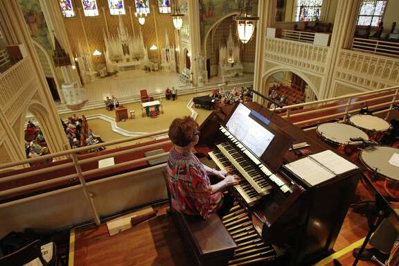 Mary J. Hernandez plays the organ in Sacred Heart Chapel at at Our Lady of the Lake University, which the Congregation of Divine Providence founded.