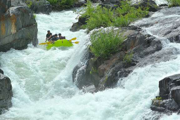 A rafting trips readies to plunge through a whitewater chute on the Middle Fork American River