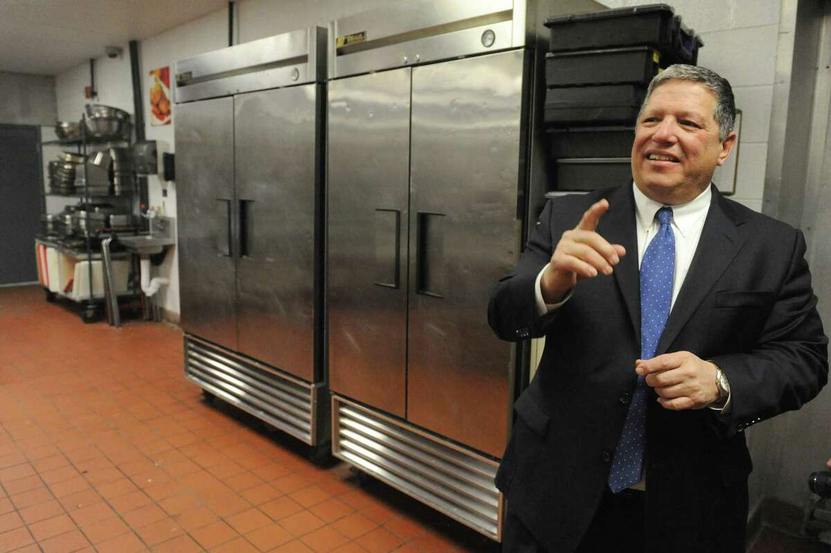Angelo Mazzone, right, gives a guided tour during an unveiling of the new headquarters and catering center of Mazzone Hospitality in 2015. Click through the gallery to see more of the Mazzone empire.