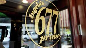 Door sign at Angelo's 677 Prime Monday morning, Sept. 21, 2015, on Broadway in Albany, N.Y. Mazzone Hospitality spent $300,000 in renovations to its flagship steakhouse. The restaurant is celebrating its 10th anniversary this year. (Will Waldron/Times Union)