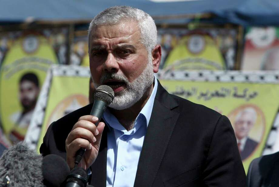 Ismail Haniyeh, the new Hamas leader speaks to the press during his visit to a solidarity tent for hunger-striking Palestinian prisoners held by Israel, at the main square in Gaza City, Monday, May 8, 2017. Ismail Haniyeh stopped by the tent Monday, two days after Hamas announced that the former Gaza prime minister replaced Qatar-based Khaled Mashaal in the Islamic militant group's top position. (AP Photo/Adel Hana) Photo: Adel Hana, STF / Copyright 2017 The Associated Press. All rights reserved.