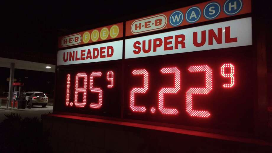 A motorist fills up at the H-E-B gas station on Clear Lake City Boulevard in Houston a few days after OPEC's decision to cut oil production. Photo: Bill Montgomery