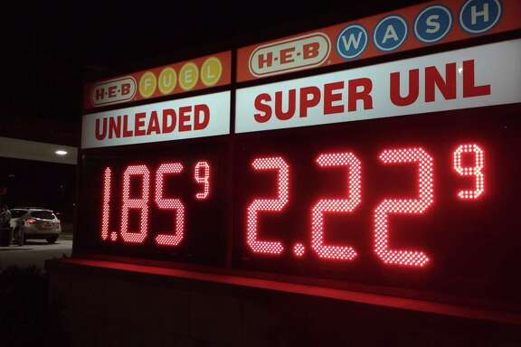 A motorist fills up at the H-E-B gas station on Clear Lake City Boulevard in Houston a few days after OPEC's decision to cut oil production.