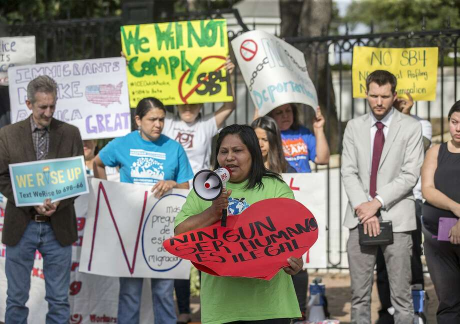 Maria Duque speaks during a protest outside of the Texas Governor's Mansion in Austin, Texas, Monday, May 8, 2017. The gathering was to protest a law, which takes effect in September and which critics say is the most anti-immigrant since a 2010 Arizona law, that will allow police officers to ask about the immigration status of anyone they detain, including during routine traffic stops. Republican Gov. Greg Abbott signed the law Sunday evening on Facebook Live with no advanced warning. (Ricardo B. Brazziell/Austin American-Statesman via AP) Photo: Ricardo B. Brazziell, MBO / Associated Press / Austin American-Statesman