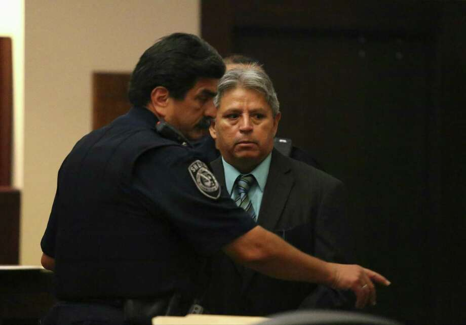 Reyes Deleon, 61, a former San Antonio high school teacher serving a 15-year sentence for aggravated sexual assault of a child. Deleon is shown being led out of a courtroom in 2014. Photo: San Antonio Express-News File Photo / © 2014 San Antonio Express-News