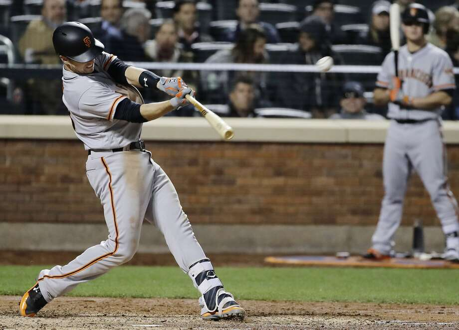 San Francisco Giants' Buster Posey hits a home run during the sixth inning of a baseball game against the New York Mets, Monday, May 8, 2017, in New York. (AP Photo/Frank Franklin II) Photo: Frank Franklin II, Associated Press