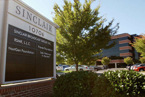 FILE - In this Tuesday, Oct. 12, 2004, file photo, Sinclair Broadcast Group, Inc.'s headquarters stands in Hunt Valley, Md. Sinclair Broadcast Group, one of the nation's largest local TV station operators, announced Monday, May 8, 2017, that it will pay about $3.9 billion for Tribune Media, adding more than 40 stations including KTLA in Los Angeles, WPIX in New York and WGN in Chicago. (AP Photo/Steve Ruark, File)