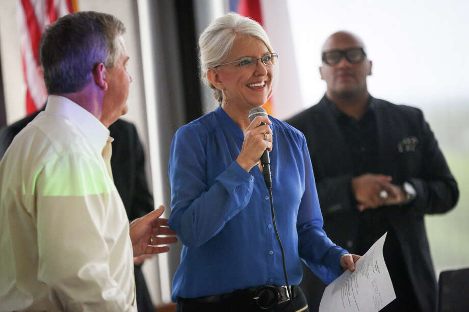 """Terri Jaggers, President and Chairman of the Board for Montgomery County CPS, smiles after receiving the microphone from County Judge Craig Doyal during The Foster Care Appreciation """"Love Lunch"""" on Monday, May 8, 2017, at Conroe Tower. Photo: Michael Minasi, Staff Photographer / © 2017 Houston Chronicle"""