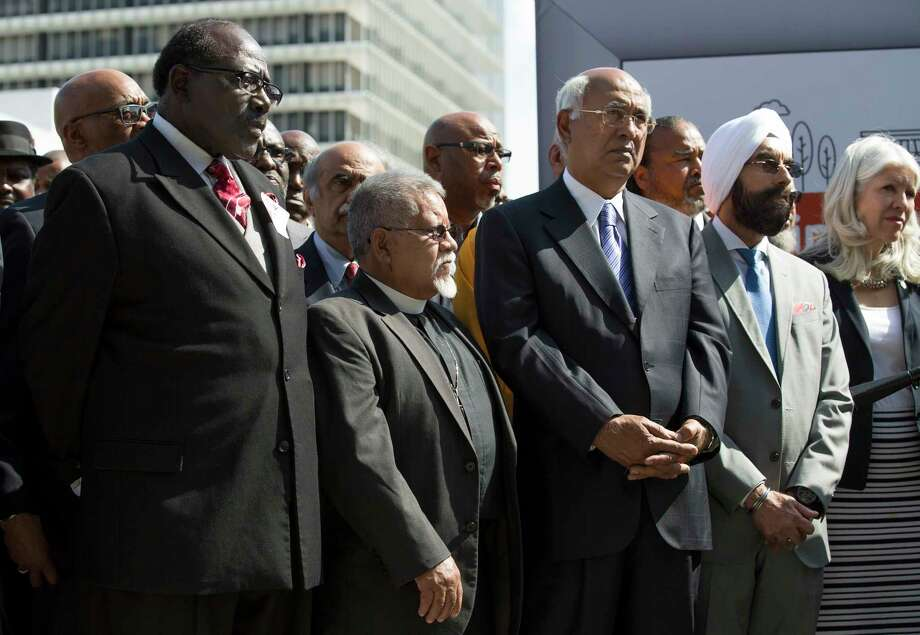 "Religious leaders of various faiths listen as Mayor Sylvester Turner launches the ""Meaningful Change"" campaign, which helps homeless people into apartments. Photo: Godofredo A. Vasquez, Staff / Godofredo A. Vasquez"