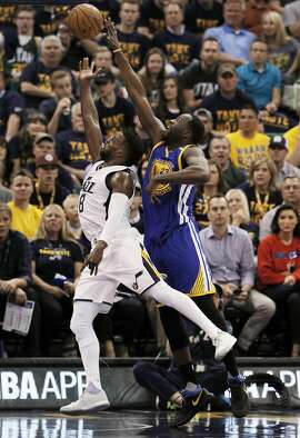 Draymond Green (23) defends against Shelvin Mack (8) in the first half as the Golden State Warriors played the Utah Jazz at Vivint Smart Home Arena in Salt Lake City, Utah, on Monday, May 8, 2017, in Game 4 of the 2017 Western Conference Semifinals. The