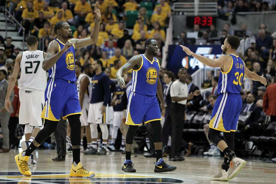 Kevin Durant (35), Draymond Green (23) and Stephen Curry (30) high five during a timeout in the second half as the Golden State Warriors played the Utah Jazz at Vivint Smart Home Arena in Salt Lake City, Utah, on Monday, May 8, 2017, in Game 4 of the 2017 Western Conference Semifinals. The Warriors defeated the Jazz 121-95 to sweep the series and advance to the Western Conference Finals Photo: Carlos Avila Gonzalez, The Chronicle
