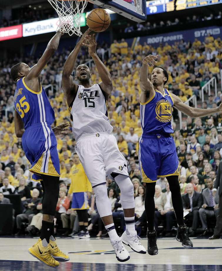 The Warriors' Kevin Durant (left) and Shaun Livingston defend against Jazz forward Derrick Favors in the second half of Game 4. Favors, troubled by back and knee trouble, was emblematic of Utah's depth problems as the Warriors finished off the sweep. Photo: Carlos Avila Gonzalez, The Chronicle