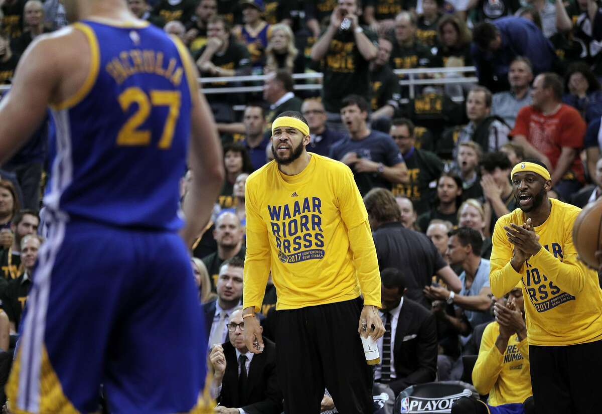 JaVale McGee (1) and Ian Clark (21) encourage Zaza Pachulia (27) from the bench in the first half as the Golden State Warriors played the Utah Jazz at Vivint Smart Home Arena in Salt Lake City, Utah, on Monday, May 8, 2017, in Game 4 of the 2017 Western Conference Semifinals. The