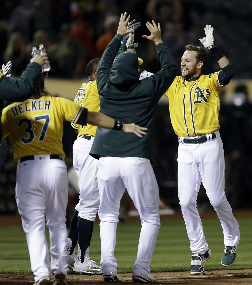 Oakland Athletics' Jed Lowrie, right, celebrates after hitting a walk off home run off Los Angeles Angels' Deolis Guerra in the eleventh inning of a baseball game Monday, May 8, 2017, in Oakland, Calif. (AP Photo/Ben Margot) Photo: Ben Margot, Associated Press