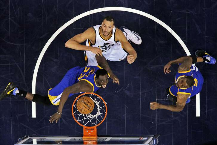 Draymond Green (23) watches his shot drop against Rudy Gobert (27) in the first half as the Golden State Warriors played the Utah Jazz at Vivint Smart Home Arena in Salt Lake City, Utah, on Monday, May 8, 2017, in Game 4 of the 2017 Western Conference Semifinals. The Warriors defeated the Jazz 121-95 to sweep the series and advance to the Western Conference Finals