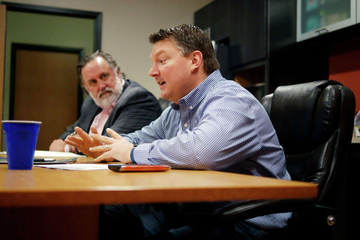 Marty Vanags, left, president of Saratoga County Prosperity Partnership, looks on as William Lindheimer, general manager for Land Remediation, Inc., talks about his company's work on Thursday, April 6, 2017, in Waterford, N.Y. (Paul Buckowski / Times Union)