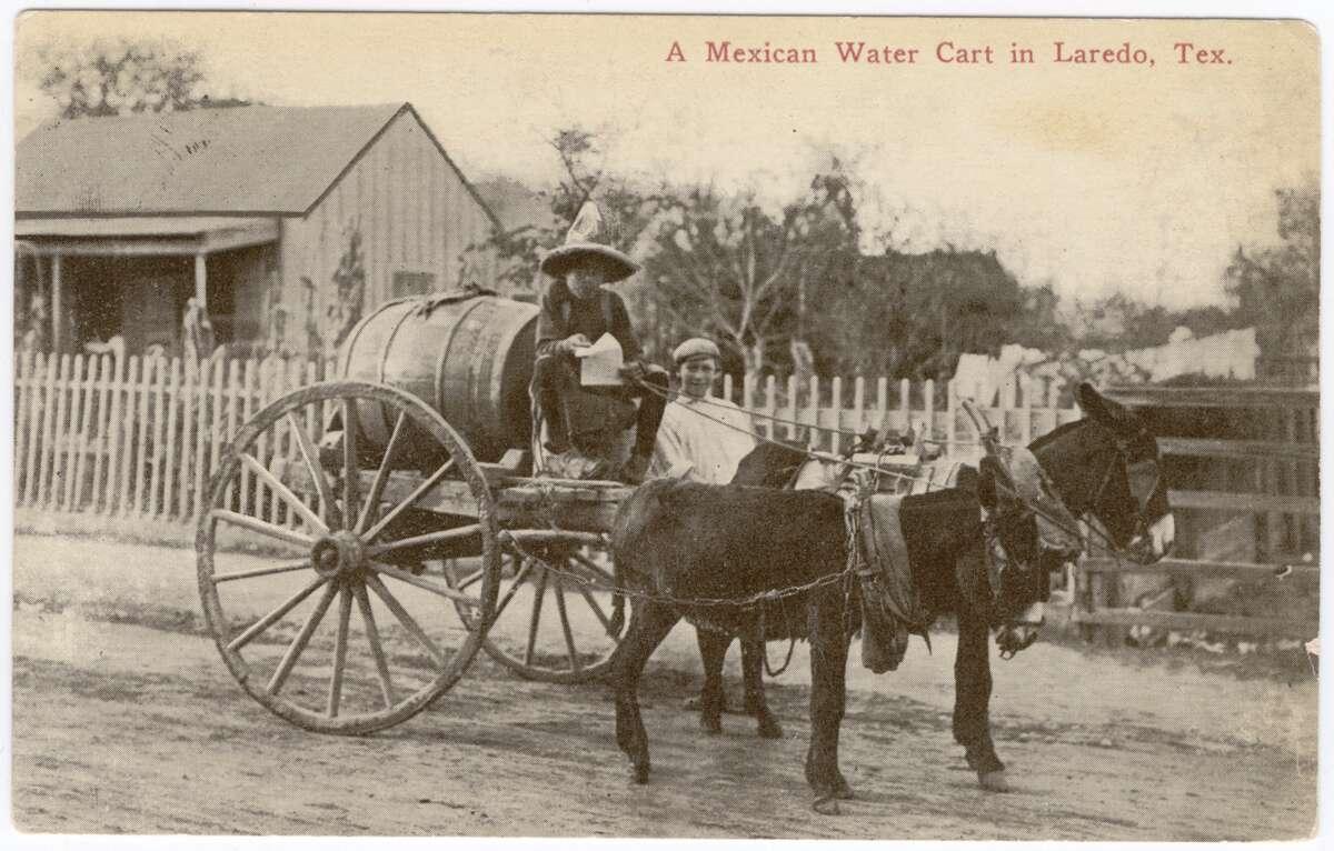 1900: A Mexican water cart in Nuevo Laredo.