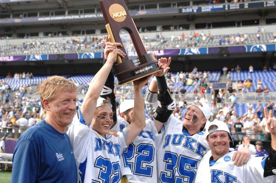Duke lacrosse coach John Danowski, Cos Cob's Sam Payton (32), Ned Crotty (22), Old Greenwich's Parker McKee (35), and Max Quinzani (9) of the Duke Blue Devils celebrate winning the 2010 NCAA Division I  last weekend at M&T Bank Stadium in Baltimore, Maryland. Photo: Mitchell Layton, Mitchell Layton/Getty Images / 2010 Mitchell Layton