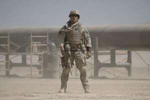"""This image released by Amazon Studios and Roadside Attractions shows John Cena in a scene from, """"The Wall."""" (David James/Amazon Studios and Roadside Attractions via AP)"""