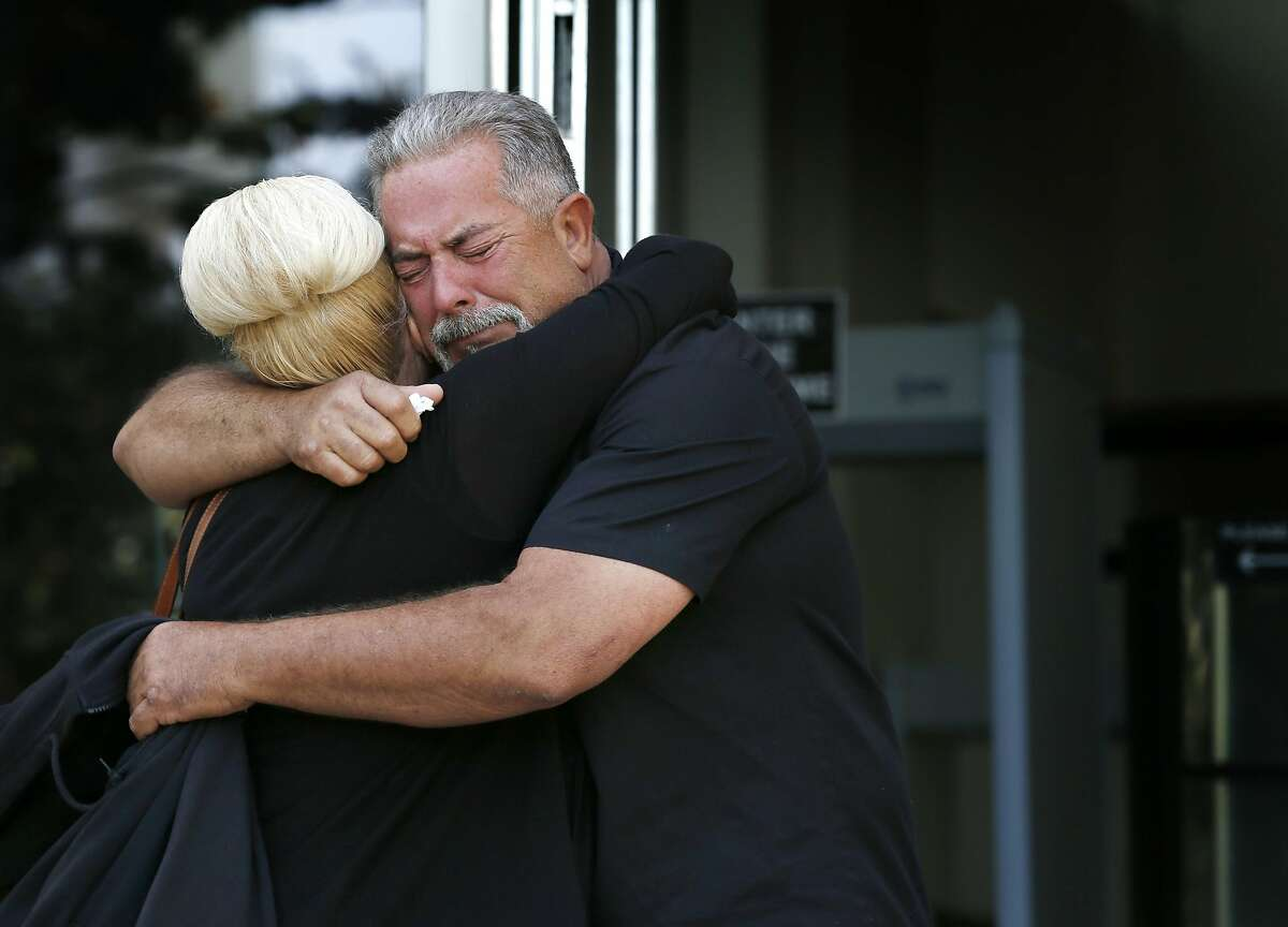 Autumn Ayres and Doug Tollis hug after Antolin Garcia Torres was found guilty for the murder of 15-year-old Sierra LaMar at the Santa Clara County Hall of Justice in San Jose, Calif. on Tuesday, May 9, 2017. Ayres and Tollis, regular volunteers in the search for LaMar, were relieved by the verdict.