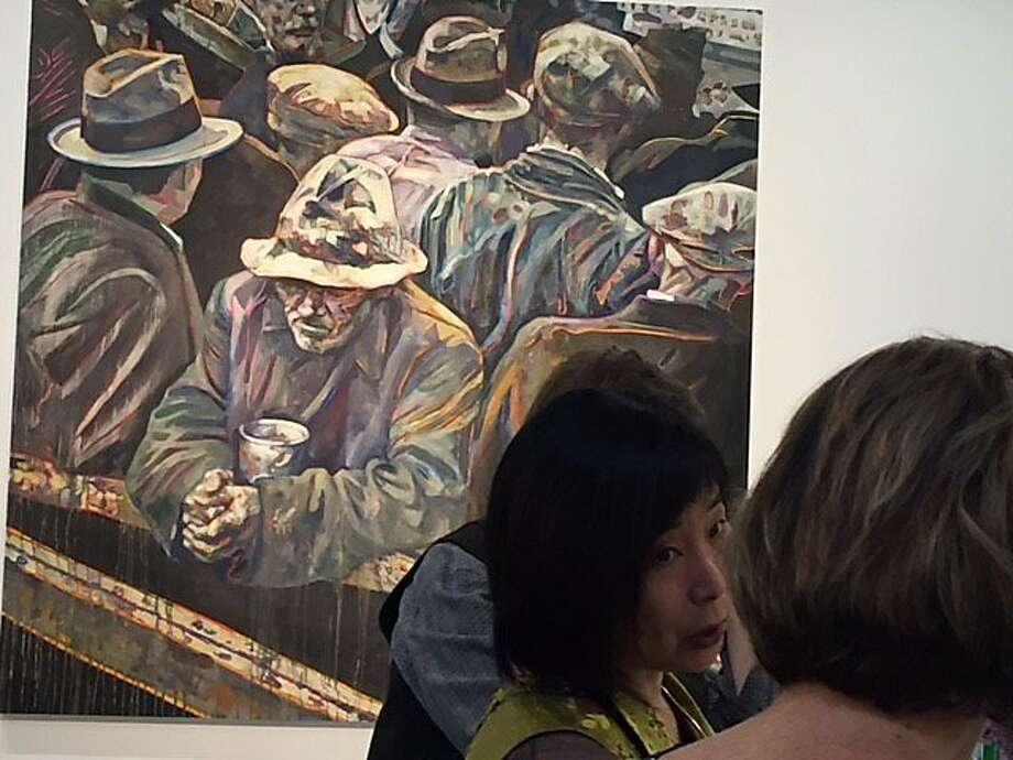 """Dinner at Rena Bransten Gallery in front of Hung Liu painting based on Lange's """"White Angel Bread Line."""" Photo: Leah Garchik, San Francisco Chronicle"""
