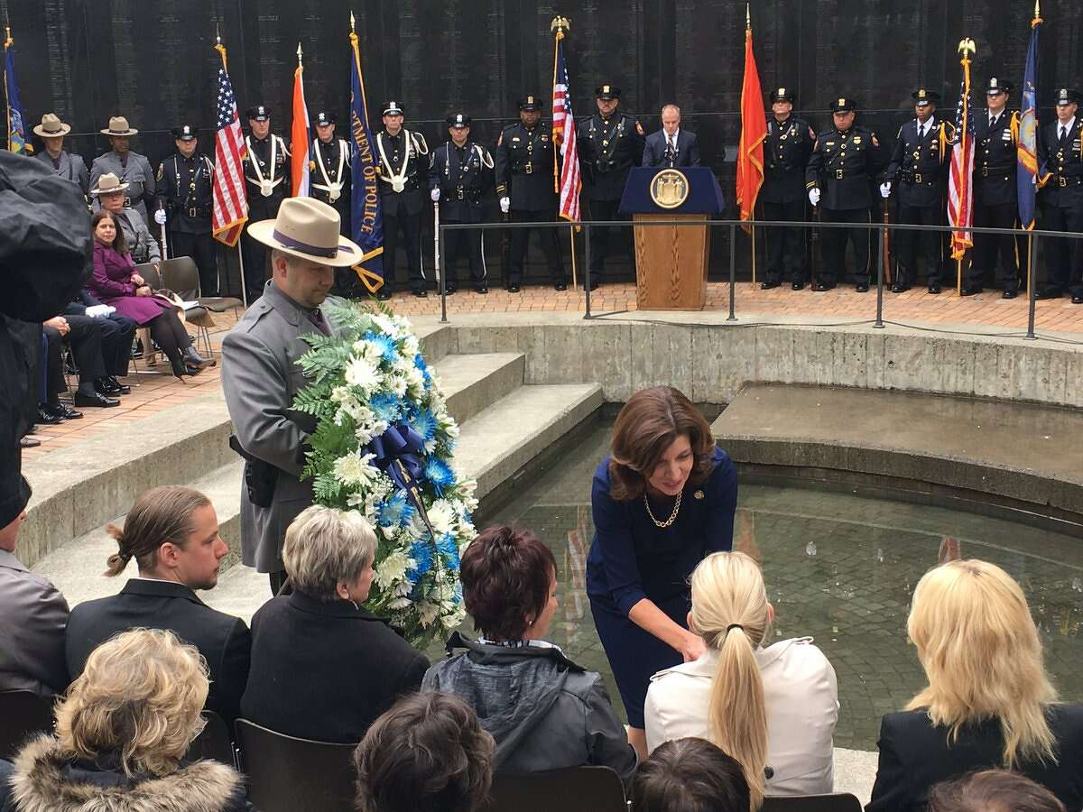 Lt. Gov. Kathy Hochulshakes the hand of Sarah Pratt, the daughter of fallen Trooper Timothy Pratt, during a memorial service Tuesday for law enforcement officers who have died as a result of work-related issues.