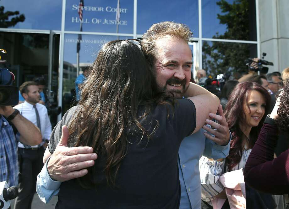 A supporter hugs Steve LaMar after Antolin Garcia Torres was found guilty for the murder of his 15-year-old daughter Sierra LaMar at the Santa Clara County Hall of Justice in San Jose, Calif. on Tuesday, May 9, 2017. Photo: Paul Chinn, The Chronicle