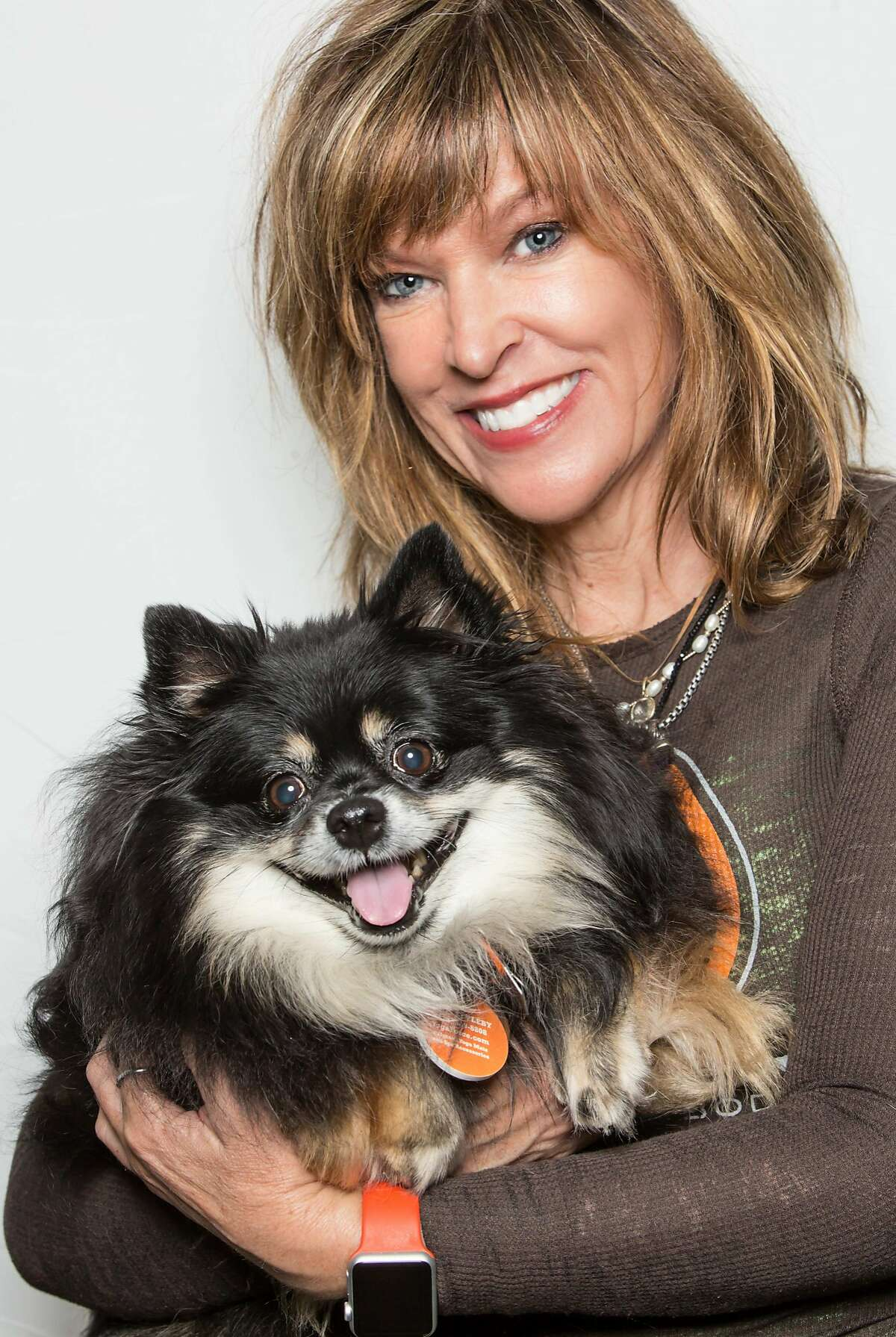 """Anne Appleby, founder of YogaForce, will be teaching """"doga"""" (dog yoga) May 18 at Wilkes Bashford Palo Alto. The event benefits the Peninsula Humane Society and the SPCA."""