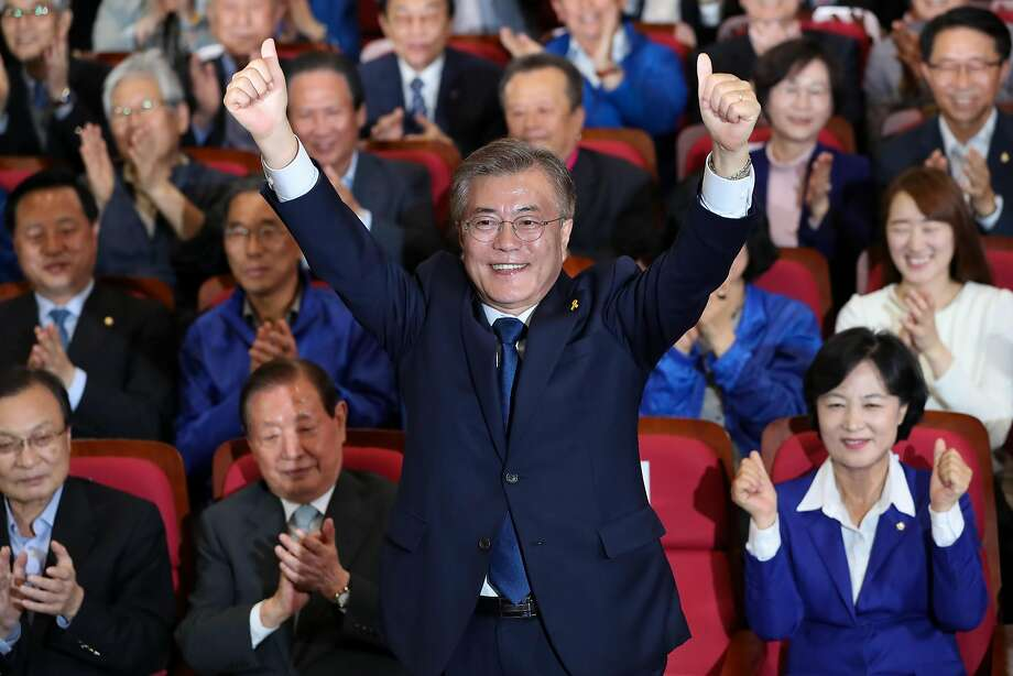 Moon Jae-in reacts after exit poll results are announced at his party's headquarters in Seoul and his two main rivals conceded defeat. Photo: SeongJoon Cho, Bloomberg