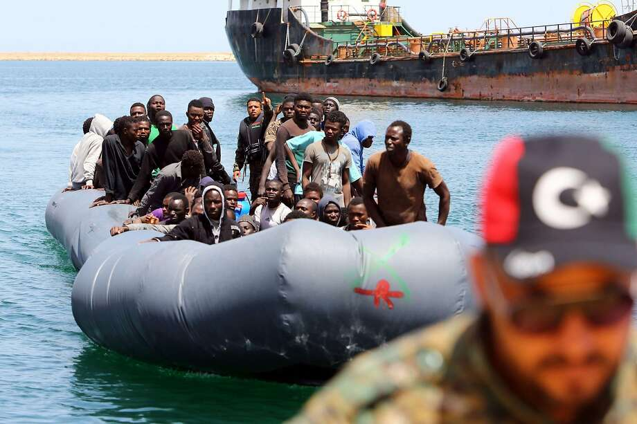 African refugees rescued by the Libyan coast guard in the Mediterranean Sea arrive at a naval base in the capital, Tripoli. Photo: MAHMUD TURKIA, AFP/Getty Images