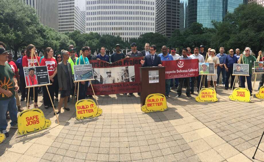 Activists and organizers gathered at Houston city hall to release a report jointly compiled by the Workers Defense Project, the Partnership for Working Families and the College of Urban Planning and Public Affairs at the University of Illinois at Chicago. Photo: Dylan Baddour