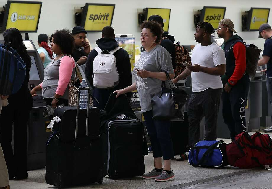 FORT LAUDERDALE, FL - MAY 09:  People stand in line to check in at the Spirt Airlines counter at the Fort Lauderdale-Hollywood International Airport on May 9, 2017 in Fort Lauderdale, Florida. Yesterday a chaotic scene erupted at the Spirit Airlines counter after flights were canceled which led to passengers getting irate and the police had to move in to restore order. Spirit blamed the delays on its pilots, who are negotiating for a new contract.  (Photo by Joe Raedle/Getty Images) Photo: Joe Raedle, Getty Images