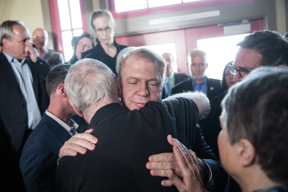 Seattle Mayor Ed Murray receives hugs as he exits the room following the announcement of his withdrawal from the 2017 mayoral race following sex abuse claims, at the Alki Beach Bathhouse on Tuesday, May 9, 2017. Photo: GRANT HINDSLEY, SEATTLEPI.COM / SEATTLEPI.COM
