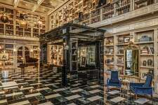 A marble floor spans the grand salon's interior, as shelves carry books and baubles from around the globe.�