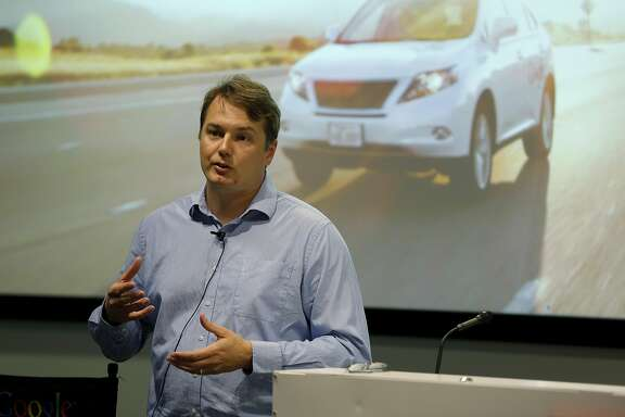 Chris Urmson, director of Google's Self Driving Cars Project, gives a presentation to reporters at a Google facility in Mountain View, California, on Tuesday, Sept. 29, 2015.