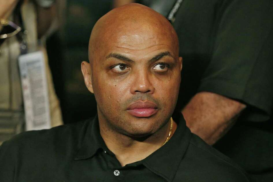 FILE - In this May 2, 2015, file photo, Charles Barkley joins the crowd before the start of the world welterweight championship bout between Floyd Mayweather Jr., and Manny Pacquiao in Las Vegas.  After LeBron James was criticized by Barkley for questioning Cleveland's front office, James tore into the former NBA star and opinionated TV commentator on Monday, Jan. 30,  following a loss in Dallas. (AP Photo/John Locher, File)