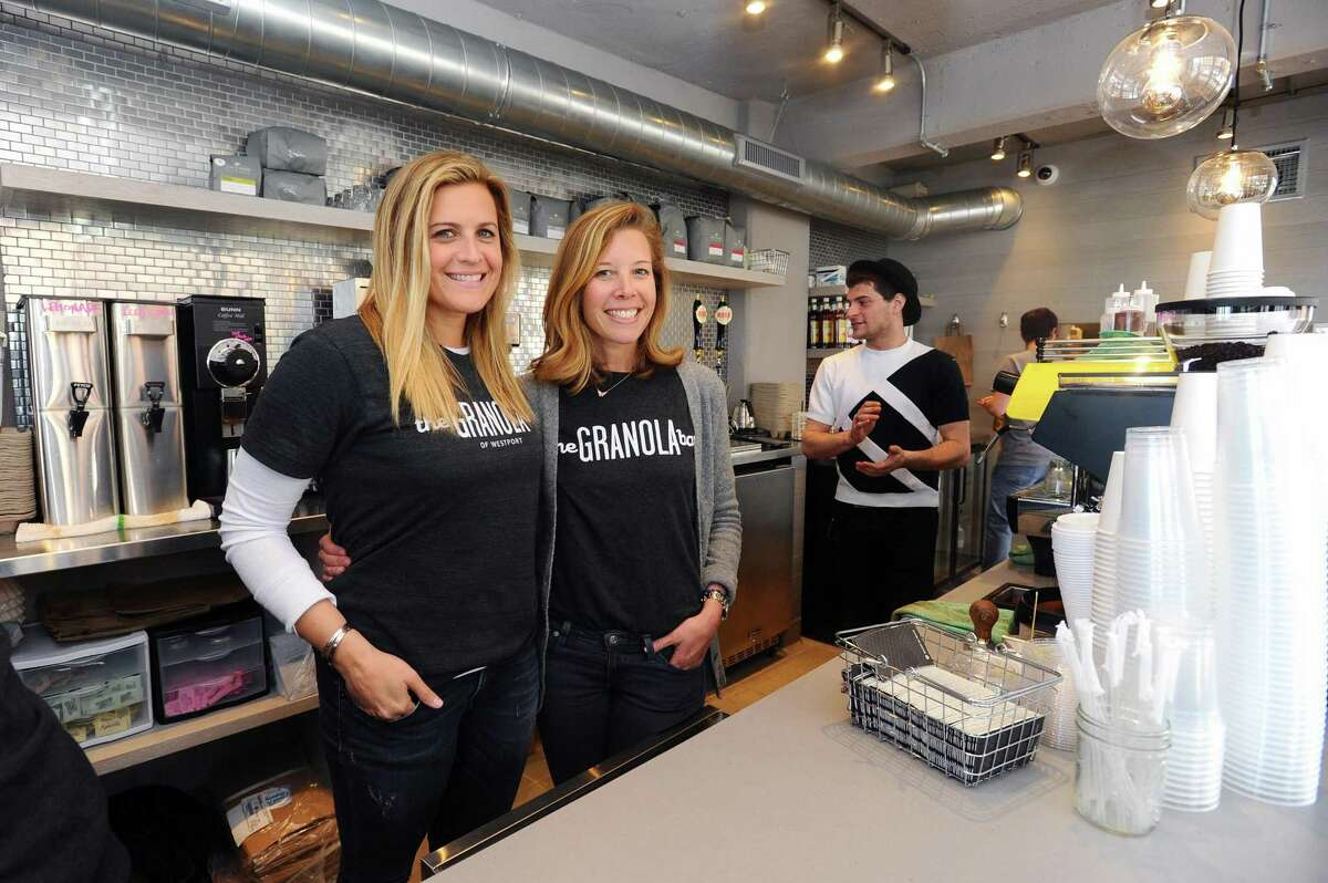The Granola Bar co-owners Julie Mountain, left, and Dana Noorily pose inside their new establishment at 700 Canal St. in Stamford, Conn. on Tuesday, May 9, 2017.